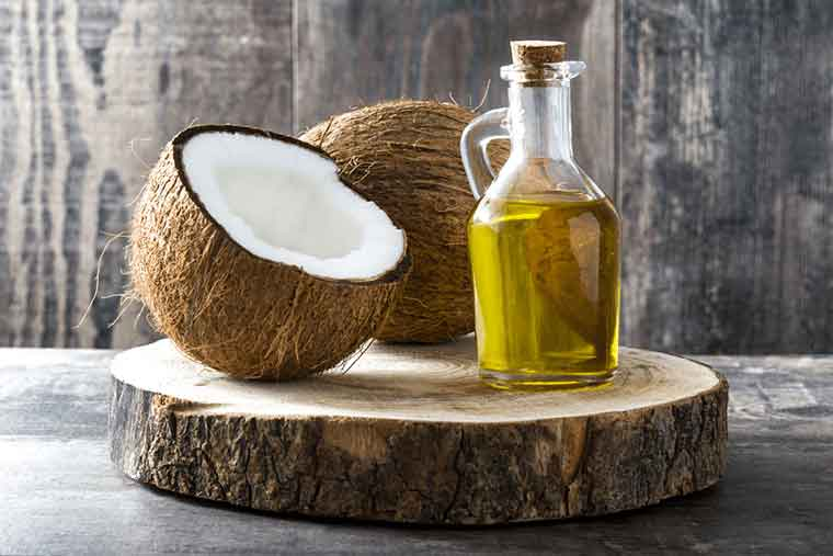 How to get rid of dandruff naturally - Coconut Oil
